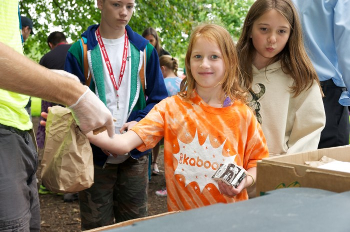 a child receives a bagged lunch
