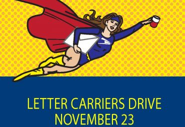 wonder woman with letter and can of food letter carriers drive november 23