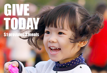 a young person smiles give today $1 provides 3 meals
