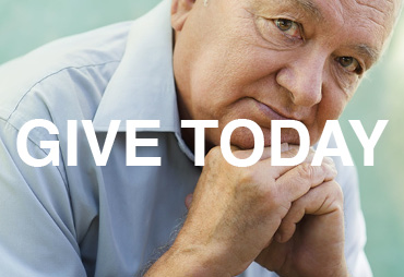 give today older person with a collared shirt and hands folded under chin